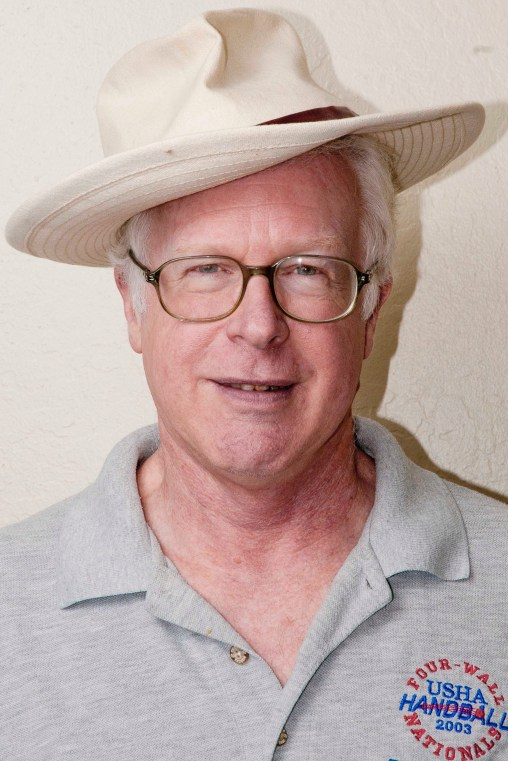White hat, light shirt, white wall, I damn near lost Brad.
