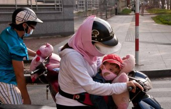 The mom and kid in front are cute, but notice the teddy bear on the bike in back