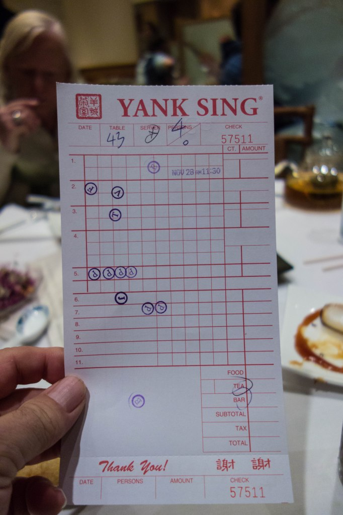 The bill--as each dish is dropped off, a mark is made.  They add it all up at the end.