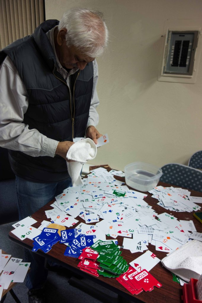 Ravi Bhalla sorts hundreds of jumbled bidding cards