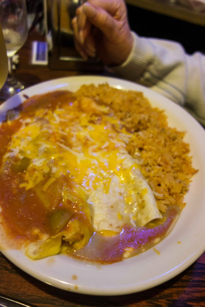 An enchilada and a chile relleno