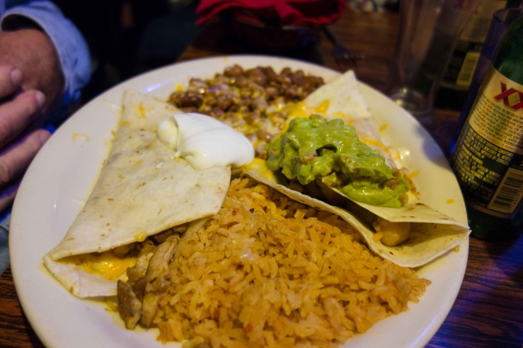 Two tacos, rice, beans and the ubiquitous guacamole