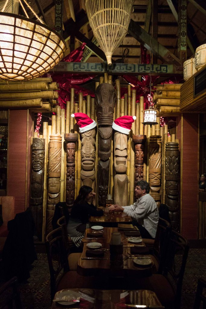It seems like it would be impossible to make Trader Vic's any more kitschy, but then they added the Santa hats to the Kiki gods