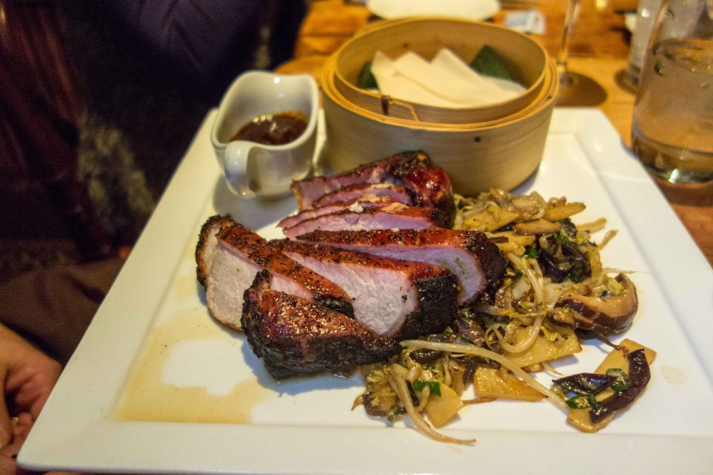 Boneless pork chop, mu shu pancakes and vegetables.
