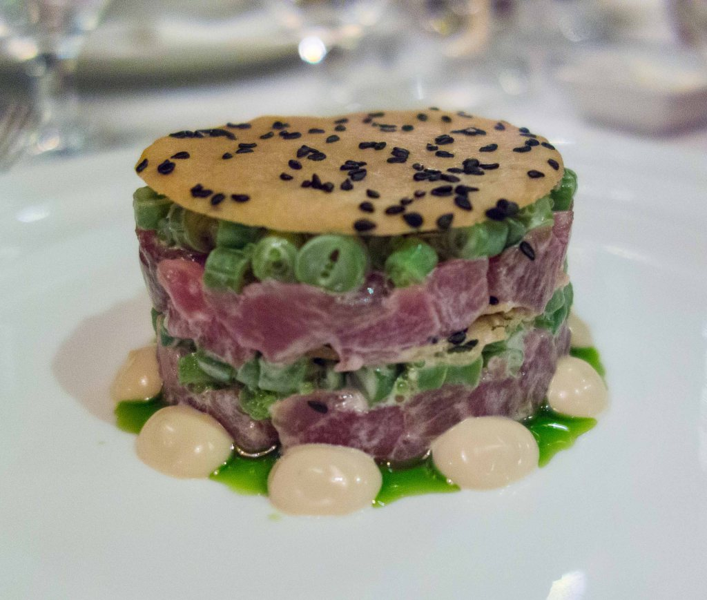 Tuna Tartare Napoleon, with haricots verts, wasabi flying fish roe, pickled ginger, yuzu aioli and sesame tuile