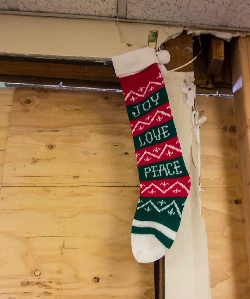 The stocking was hung by the damage with care