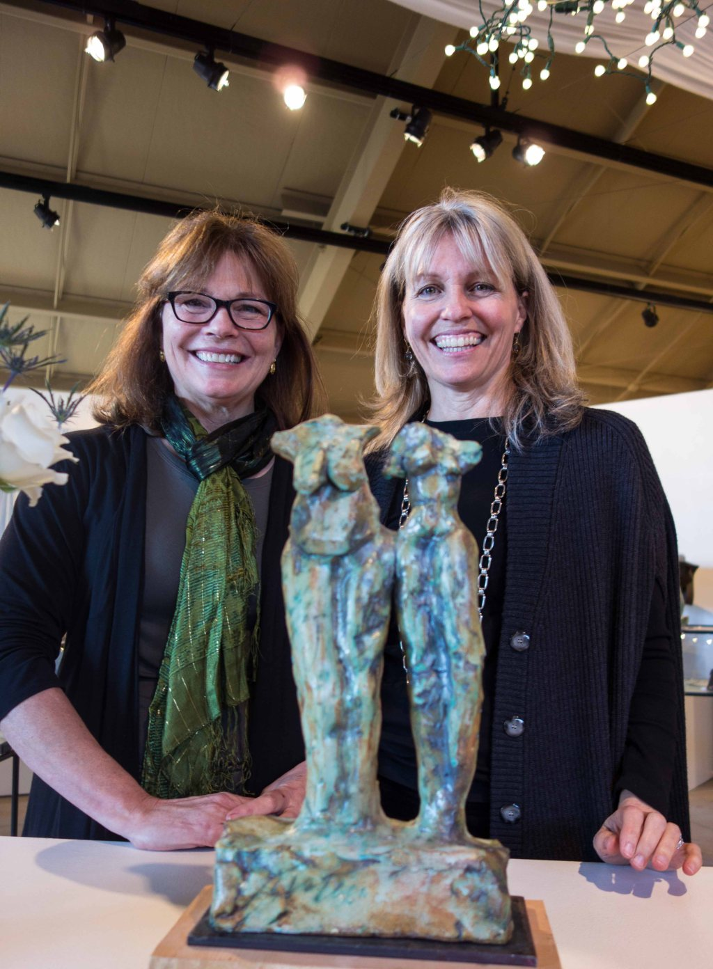"Jane and Tyler Burton.  The sculpture is Jane's piece ""Sisters"""