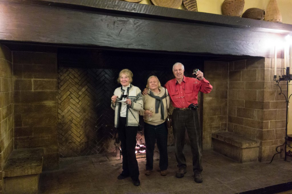 Jeannie, Gail and Bill inside one of the mammoth fireplaces.