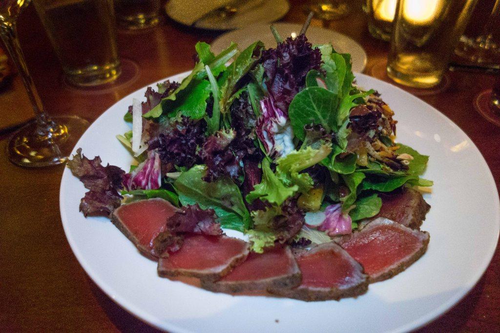 Maui Tuna Crunch sushi-grade seared tuna, organic greens, pineapple, toasted almonds, miso vinaigrette