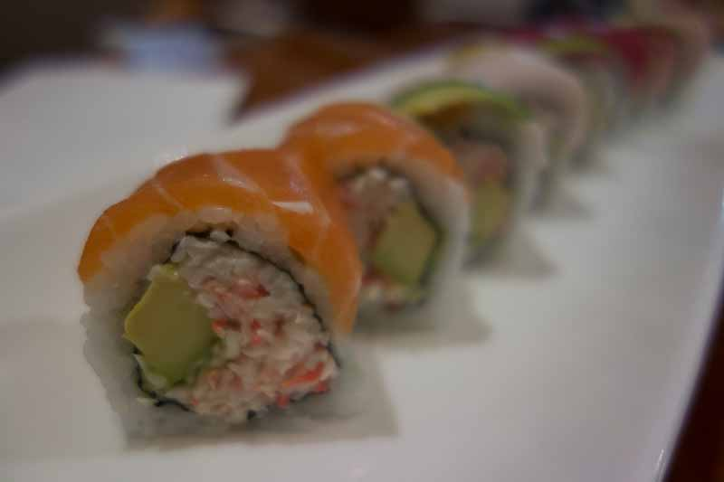 Rainbow roll--crab inside, then rice, then various cuts of fish.