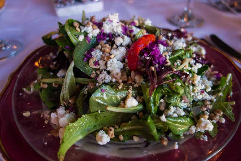 Baby lettuces, red onion, blue cheese and toasted walnuts with balsamic vinaigrette