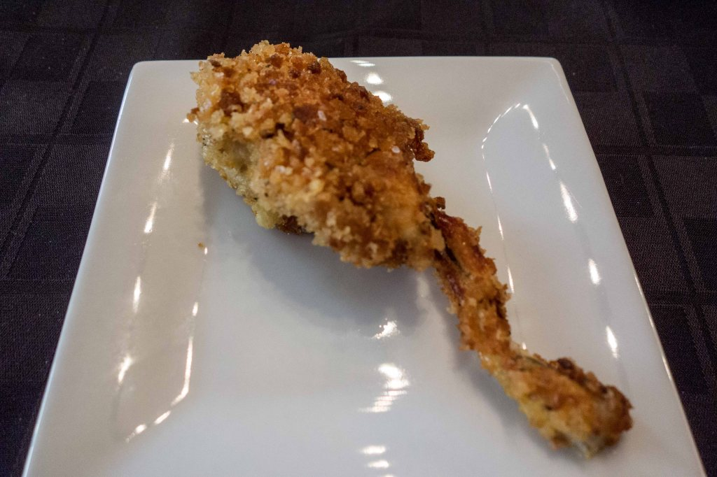 Breaded and fried frog leg.