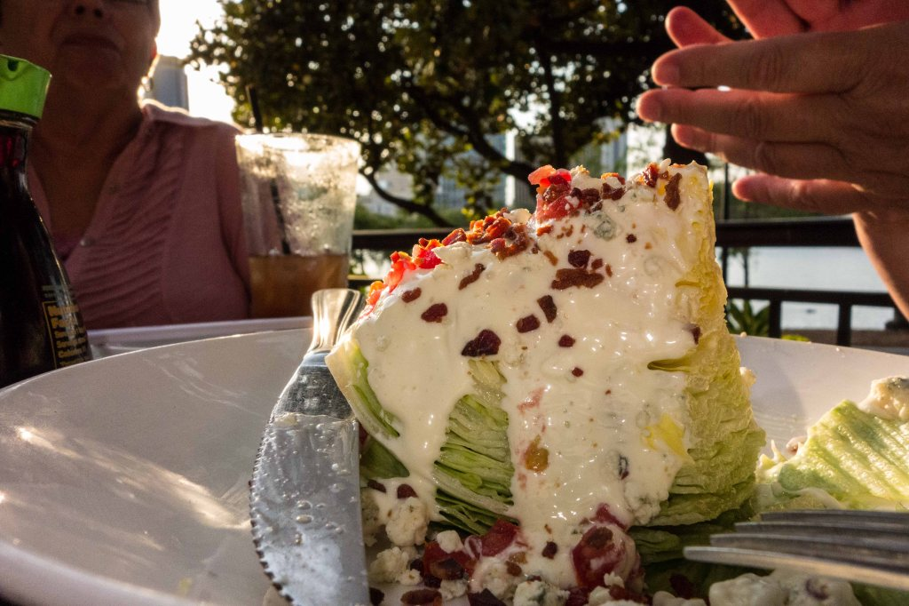 A big ol' hunk of lettuce, blue cheese dressing, tomatoes and bacon.  1950 is calling and it wants its salad back.
