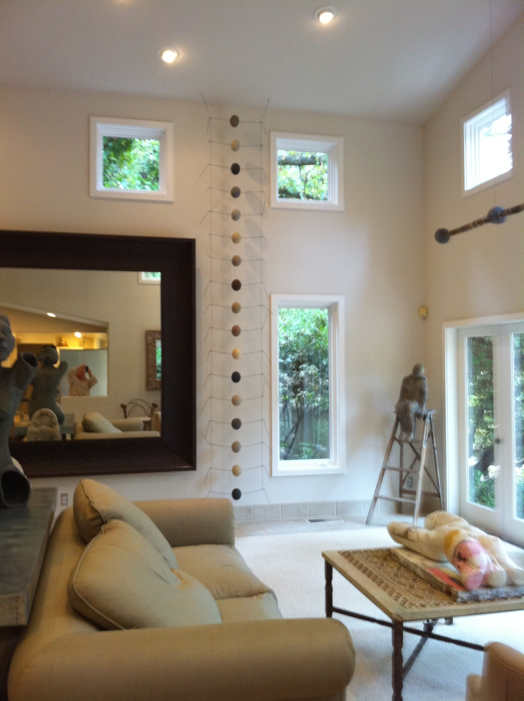 The long ladder-like item next between the mirror and the window.  It is ceramic balls on a wire frame.