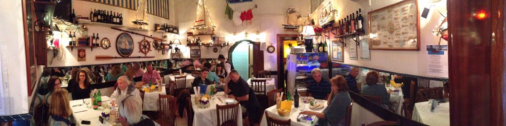 A panoramic photo of the entirety of this tiny restaurant.
