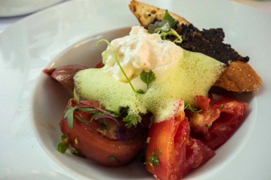 - Marinated Heirloom Tomatoes, Burrata Cheese, Oil Cured Tapenade, Fines Herb Emulsion