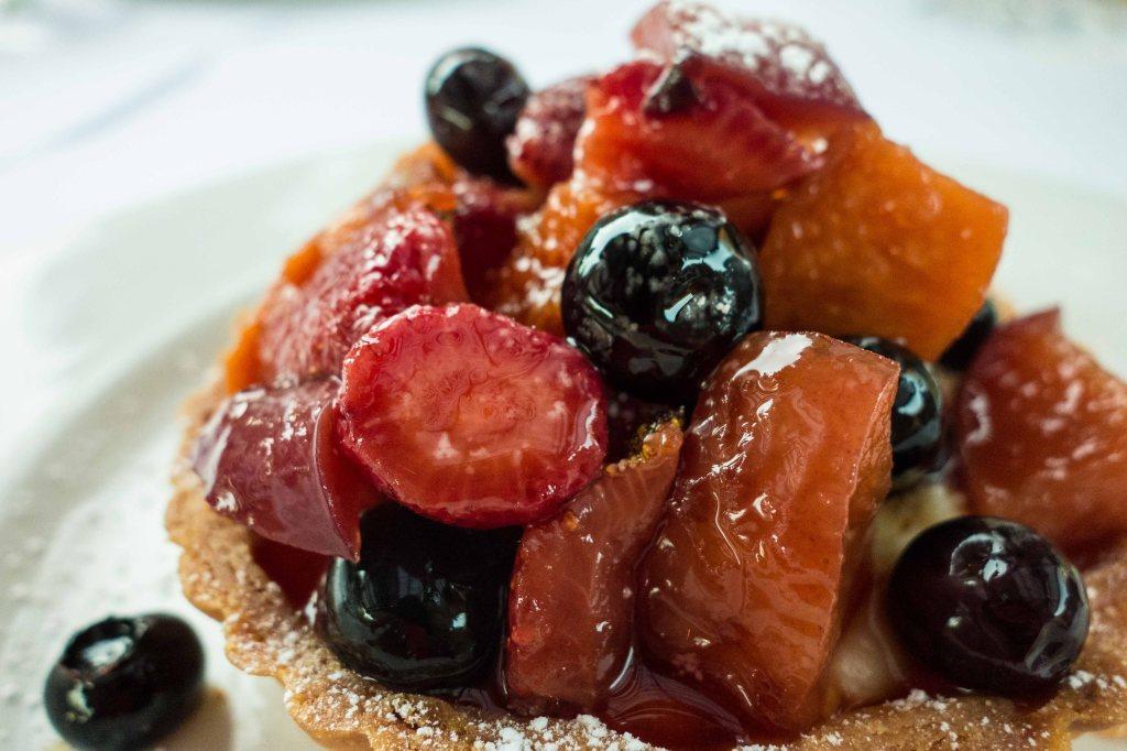 Stone fruit tart on vanilla custard