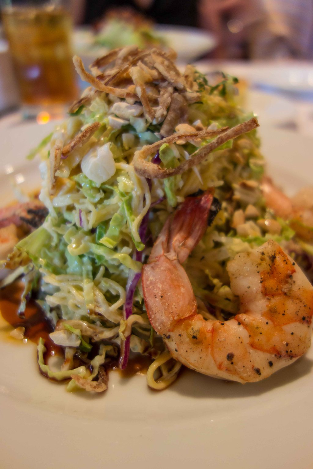 A healthy stack of cabbage and cold noodles, sesame dressing and some prawns.