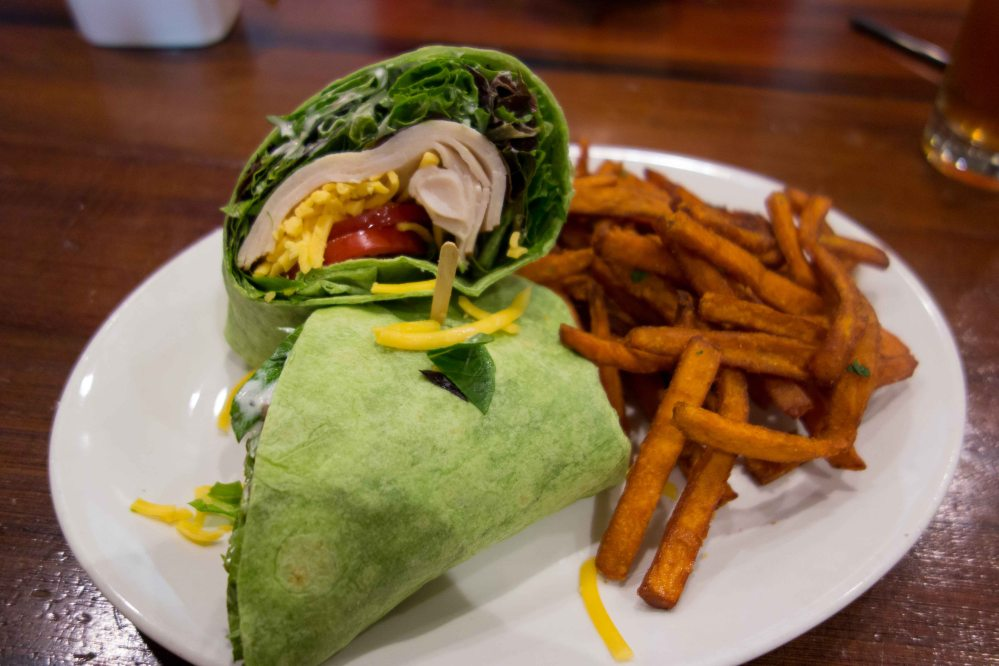 Turkey ranch wrap with sweet potato fries.