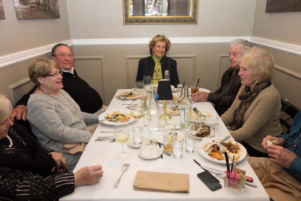 Gail, Robin Bob, Ruth, Bob, Jeannie and Bill having dinner in a phone booth.