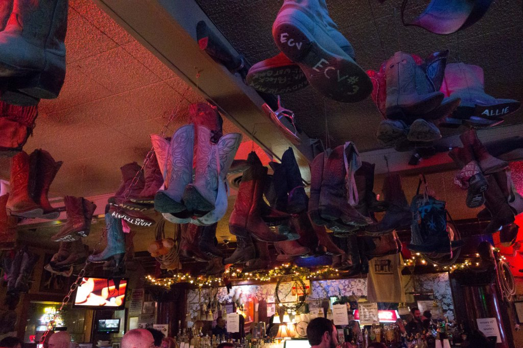 Boots hanging from the ceiling.