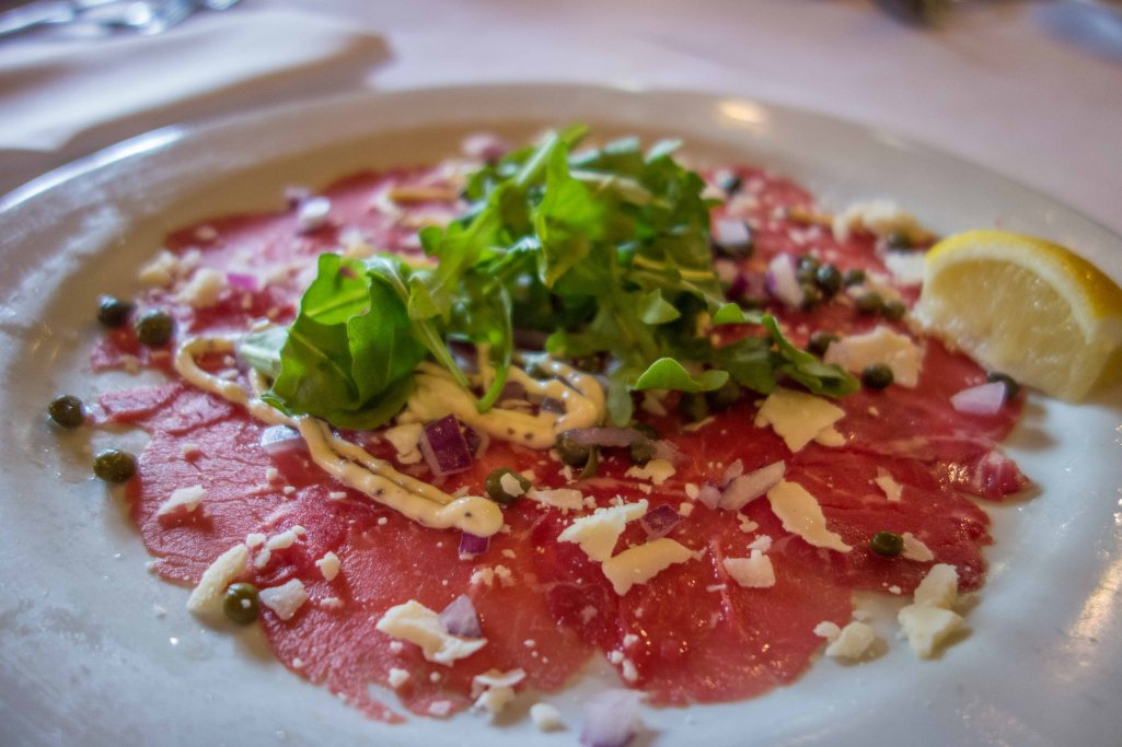 Paper thin slices of raw beef with arugula, capers, red onion and mustard sauce.