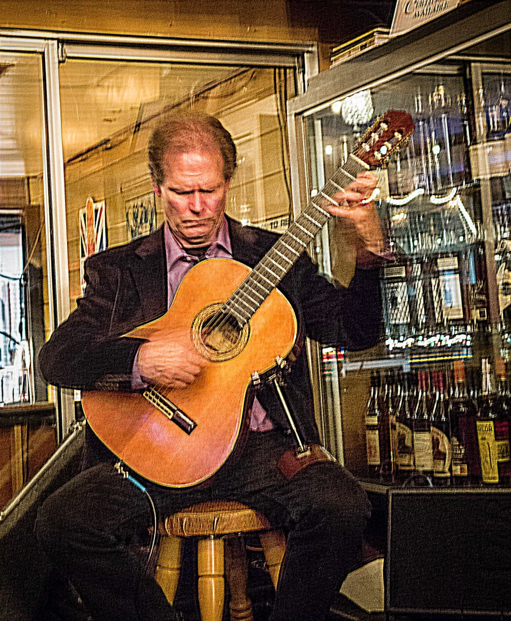 Doug Wendt playing classical guitar.
