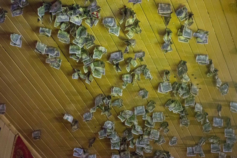 The entire ceiling is covered with money.  How do we get people to do this at our house?