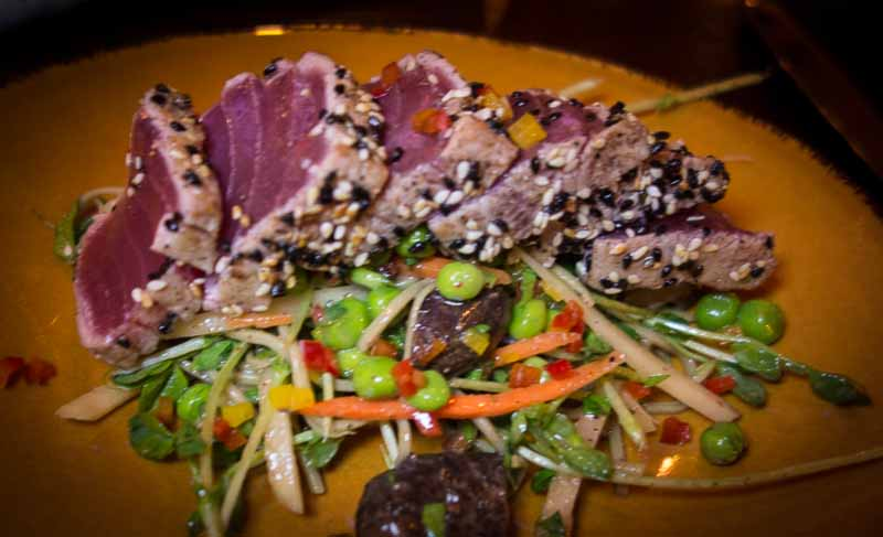 A very Asian salad topped with seared Ahi
