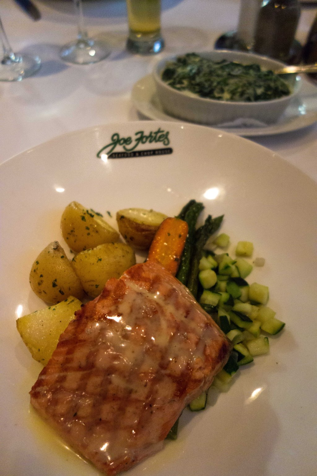 Sockeye salmon, with potatoes and veggies.  Creamed spinach in the background.