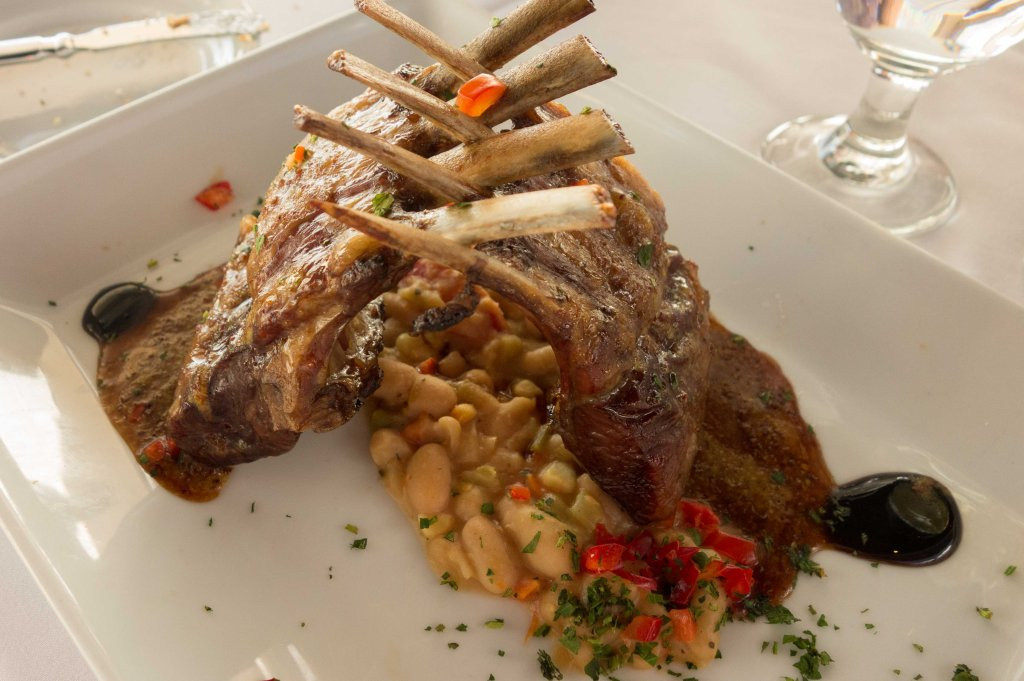 Smoked rack of lamb with bean, corn, pancetta and tomato ragout.