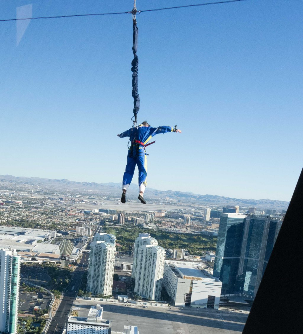 Jumping off an 800 foot tall tower just for the heck of it.