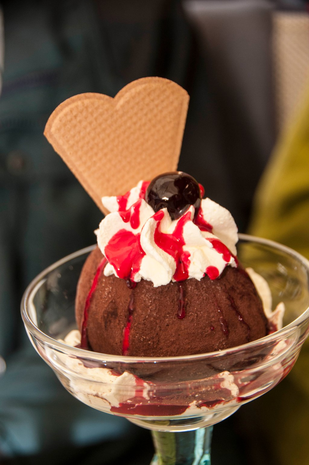 An enormous chocolate truffle, dripping with raspberry coulis.