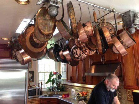 Nobody needs this many copper pans--the mundane becomes art