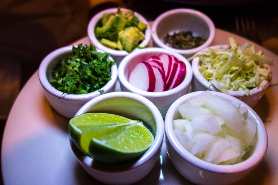 Lime, onion, radish, cabbage, avocado, oregano and cilantro.