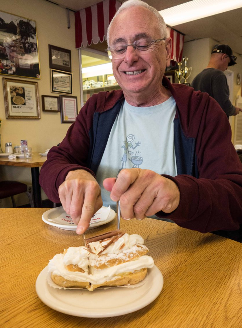 A gleeful Ed attacks his puff pastry.