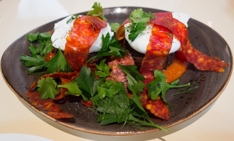 Poached eggs on falafel with Spanish chorizo.
