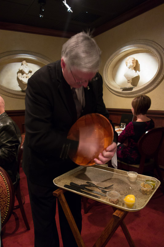 Our waiter assiduously rubbing the bowl with garlic.