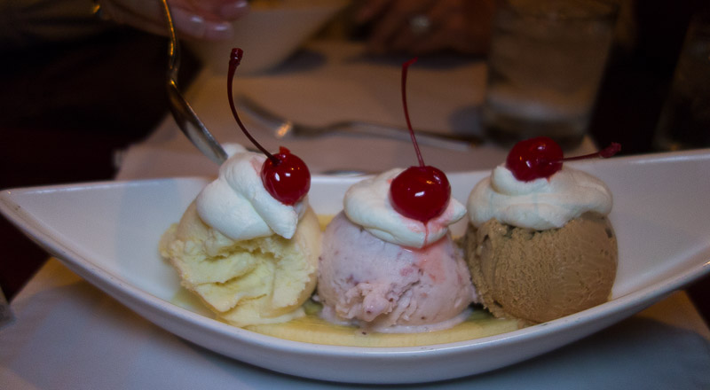 Peach, strawberry and chocolate malted ice cream and 3 cherries.  Heaven on a plate