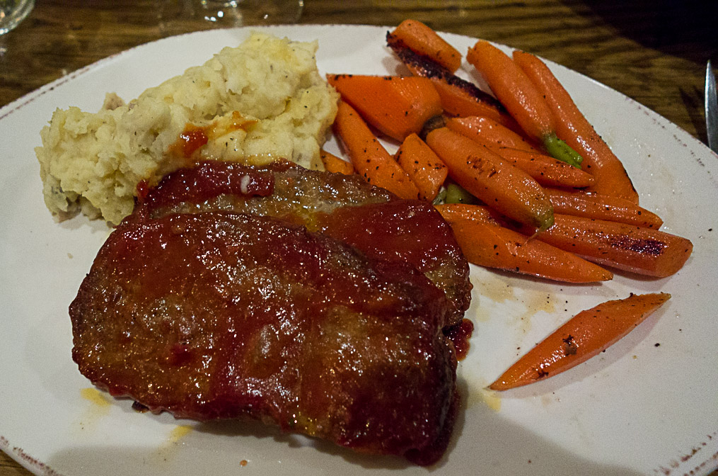 A nice presentation of serious comfort food--meatloaf, mashed spuds and carrots.