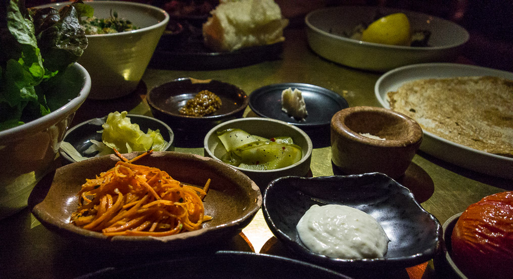 All the little dishes that accompany the meal.
