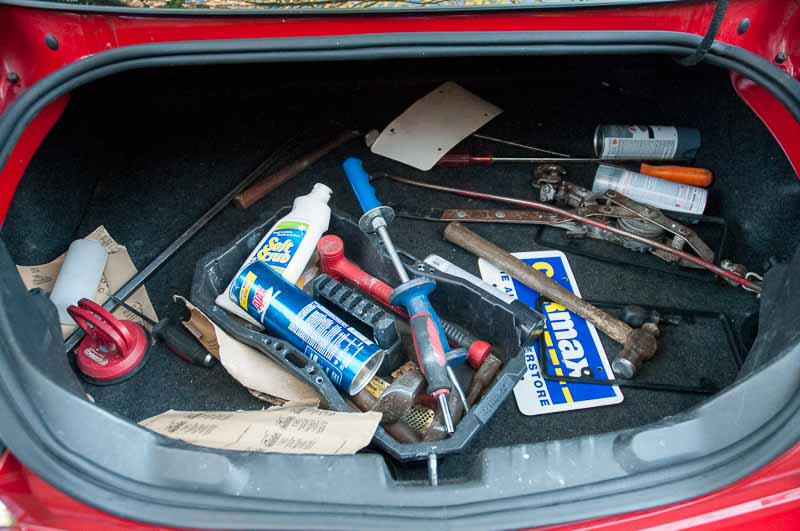 The trunk of the Camaro, with everything they needed.