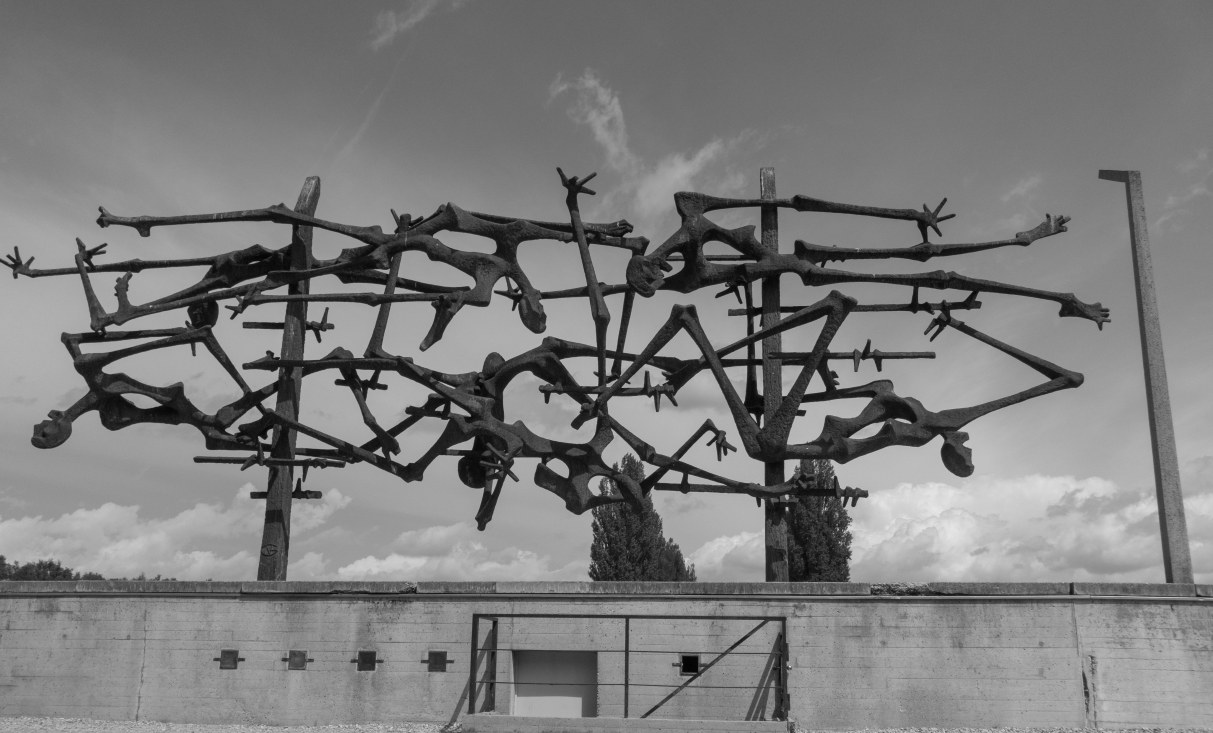 Artwork created by a former prisoner, depicting bodies on the barbed wire.