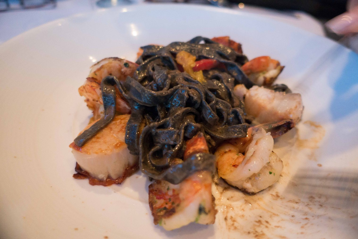 Squid-ink linguine, scallops and shrimp. Citrus black garlic sauce.