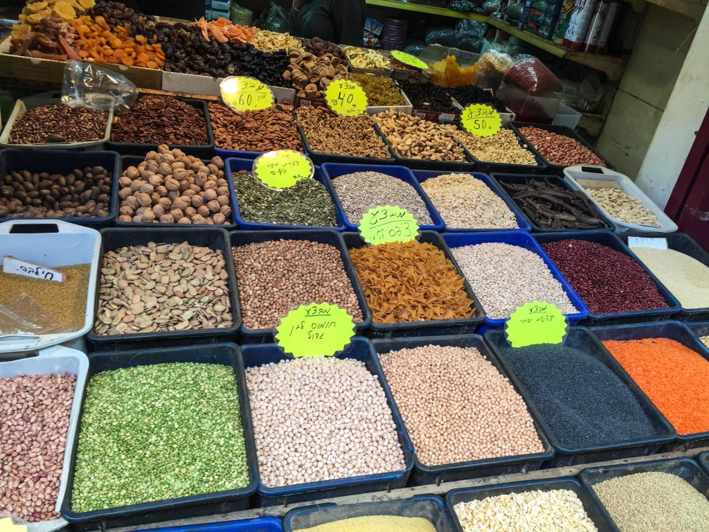 The rows of spices are like the paints in a watercolor kit.