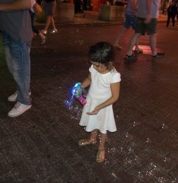 A little girl getting a bubble shooter